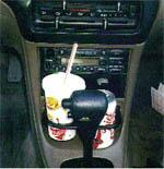 In this car, the cup holder blocks access to the radio.