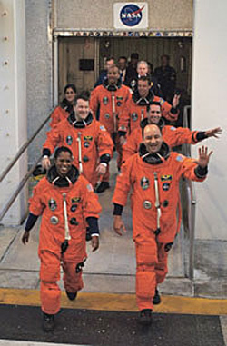 The STS-116 crew members show 