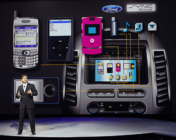 Mark Fields, Ford executive VP and president of the Americas, demonstrates Sync at the Detroit auto show in 2007.